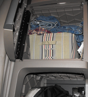 Top cabinet behind passenger seat